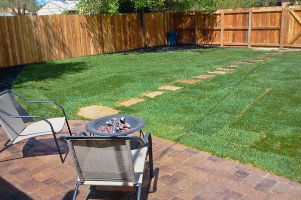 backyard with sod and fence