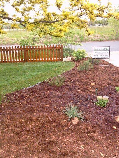 fence landscaping boulder