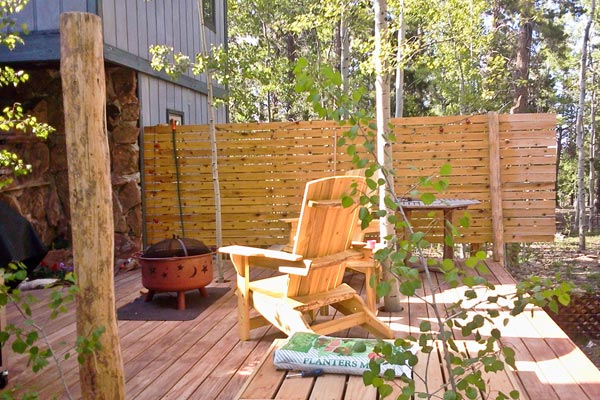 deck with aspens poking through
