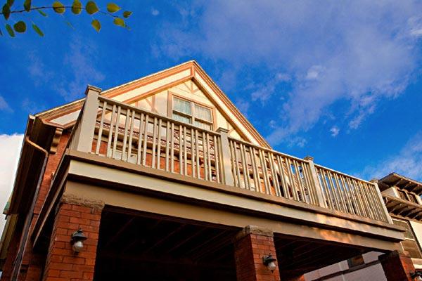 balcony deck above porch on Victorian Denver house