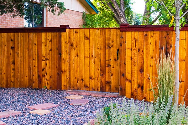 boulder fence staining and protecting
